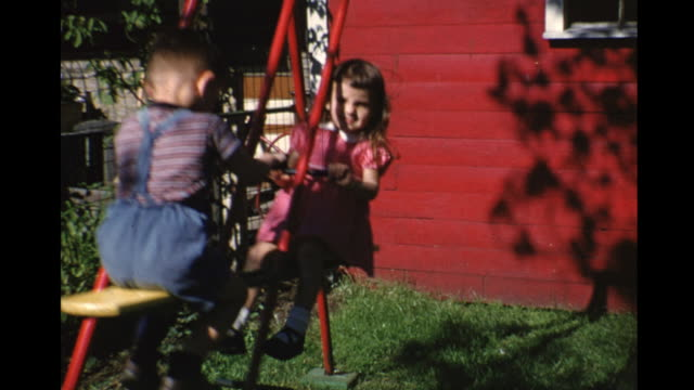 1953 montage boy (2-3) and girl on tandem swing, toronto, ontario, canada - schwester stock-videos und b-roll-filmmaterial