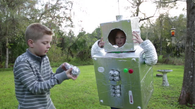 MS Boy and girl play in robot costumes.