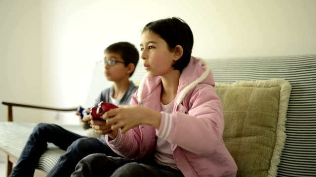 boy and girl play video game - games console stock videos & royalty-free footage