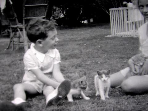 1934 boy and girl play with kittens - dayton ohio stock videos & royalty-free footage