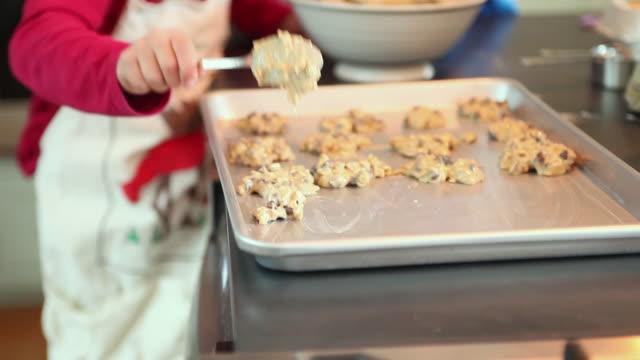ms cu focusing boy (8-9) and girl (6-7) putting cookie batter on baking sheet, yarmouth, maine, usa - baking sheet stock videos & royalty-free footage