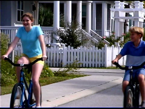boy and girl riding bicycles - see other clips from this shoot 1335 stock videos and b-roll footage