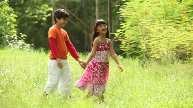 Boy and girl romancing in a park