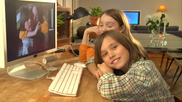 ms, boy (8-9) and girl (10-11) sitting at desk, looking at camera, portrait - brother stock videos & royalty-free footage