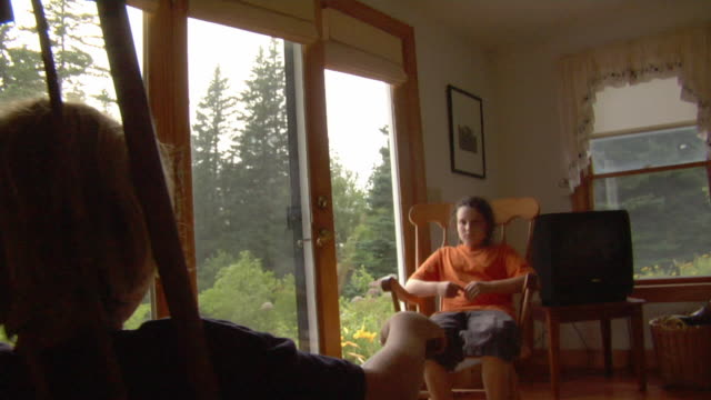 MS, SHAKY, Boy and girl (10-11) sitting on rocking chairs face to face, Vinal Haven, Maine, USA