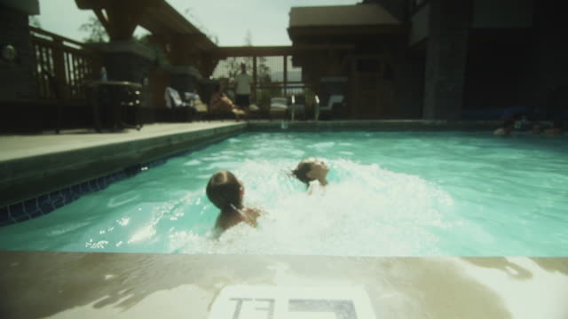 ws pan boy and girl (8-11) swimming in pool / squamish, british columbia, canada  - squamish stock videos & royalty-free footage