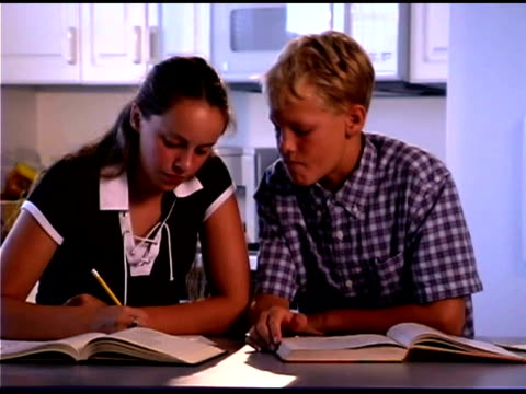 boy and girl talking about homework - bald head island stock videos & royalty-free footage