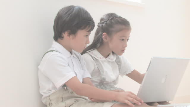 Boy and girl using PC