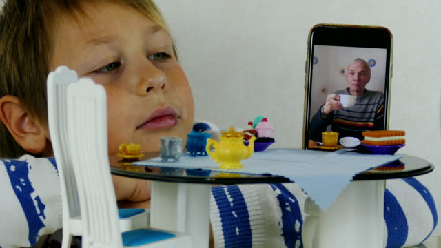 boy and grandfather communicate and drink tea via video link - over 80 stock videos & royalty-free footage