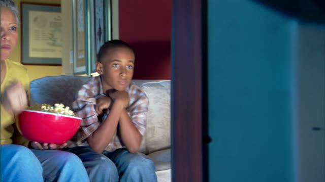 boy and grandmother watching television - andere clips dieser aufnahmen anzeigen 1282 stock-videos und b-roll-filmmaterial