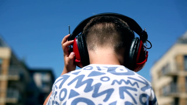 boy and headphones - headphones stock videos & royalty-free footage