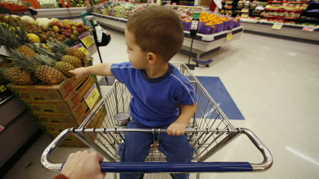 a boy and his mother grocery shopping - see other clips from this shoot 1172 stock videos & royalty-free footage