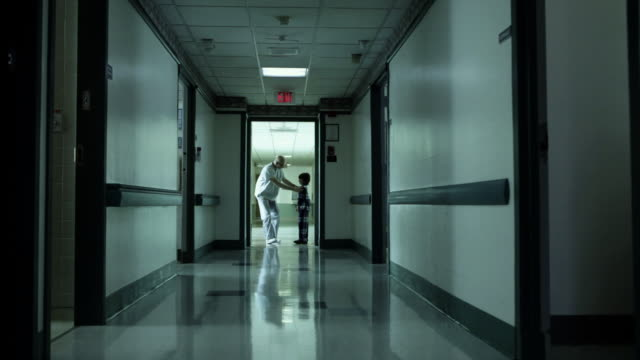 boy and male nurse walking in hospital corridor - building entrance stock videos & royalty-free footage