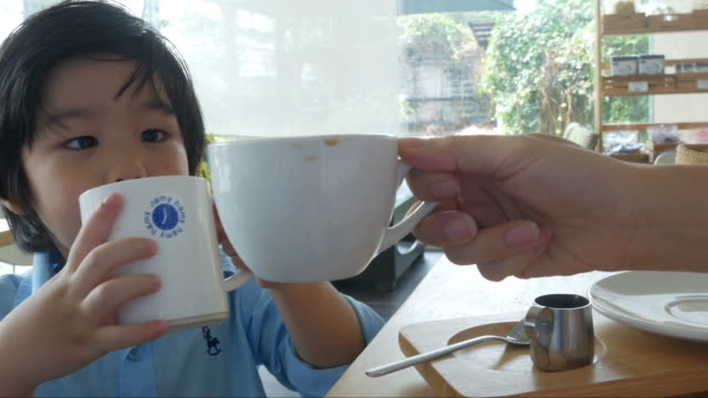 boy and mother drinking milk togetherness
