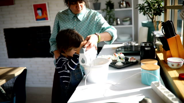 boy assisting his mom in the kitchen - single mother stock videos & royalty-free footage