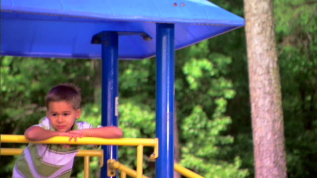 boy at a playground - see other clips from this shoot 1428 stock videos & royalty-free footage