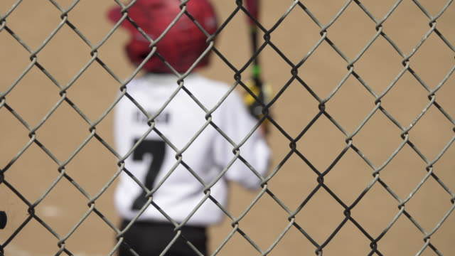 boy at bat and batting in a little league baseball game. - little league stock videos and b-roll footage