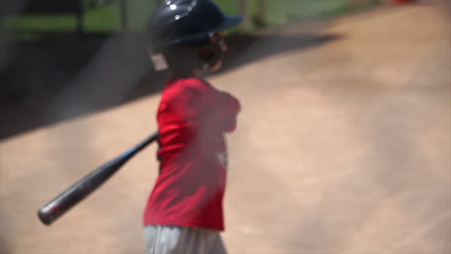 a boy at bat while playing little league baseball. - slow motion - batting stock videos & royalty-free footage