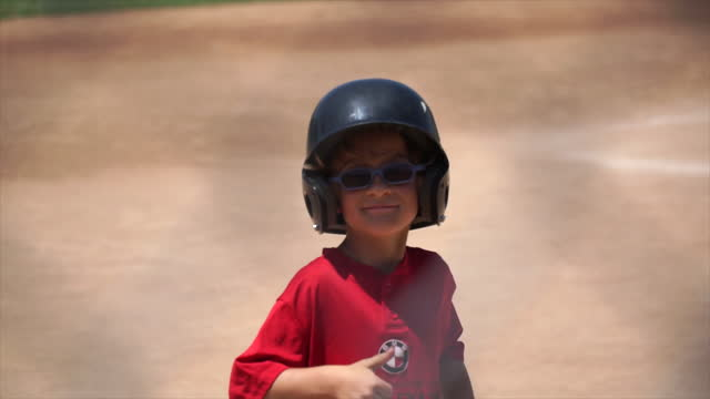 a boy at bat while playing little league baseball. - slow motion - boys stock videos & royalty-free footage