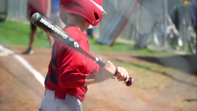a boy at bat while playing little league baseball. - slow motion - one boy only stock videos & royalty-free footage