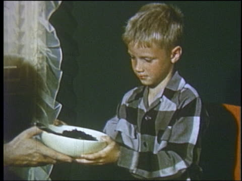 1952 boy at dinner table being passed bowl of vegetables - 1952 stock videos & royalty-free footage