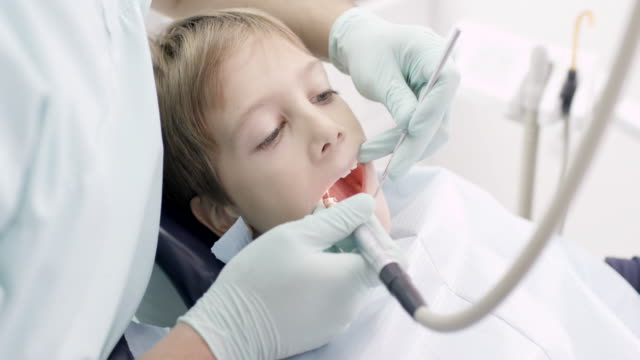boy at the dentist - glove stock videos and b-roll footage