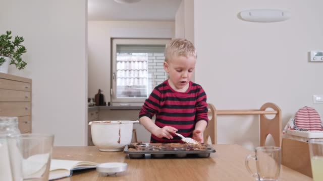 boy baking muffins at home - baking tray stock videos & royalty-free footage