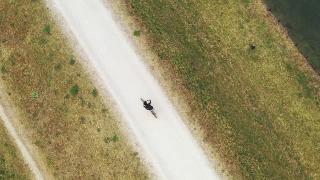 boy biking on a path, aerial view. - 8 9 years stock videos & royalty-free footage