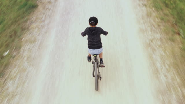 boy biking on a trail, aerial view - 8 9 years stock videos & royalty-free footage