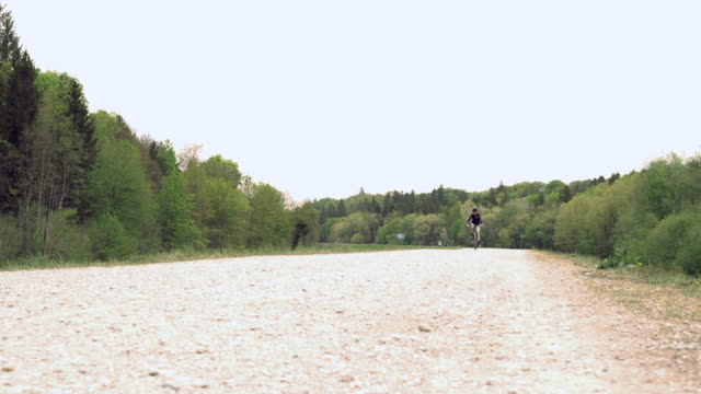 boy biking on a trail, low angle front view - 8 9 years stock videos & royalty-free footage
