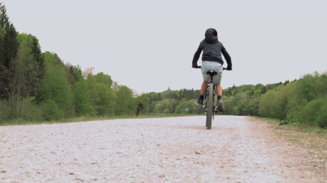 boy biking on a trail, low angle rear view - 8 9 years stock videos & royalty-free footage