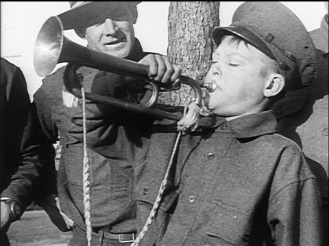 b/w 1917 boy blowing bugle at military training camp / ww i / documentary - 1917 stock videos & royalty-free footage