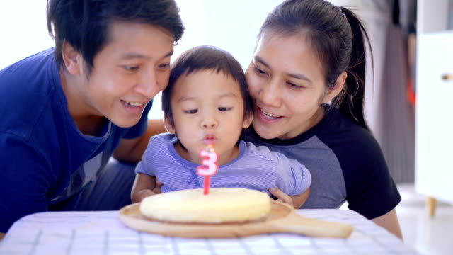 boy blowing out birthday candles with parent. - 2 3 years stock videos & royalty-free footage