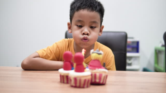 boy blowing out his birthday cake candles. - birthday gift stock videos & royalty-free footage
