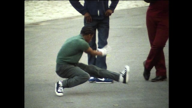 a boy breakdances in a public park in new york; 1984 - fashionable stock videos & royalty-free footage