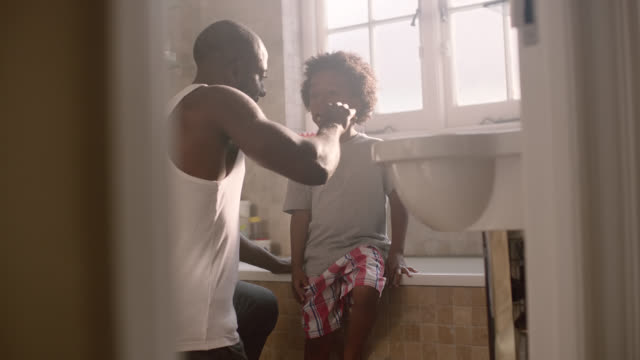 boy brushing teeth - social issues stock videos & royalty-free footage