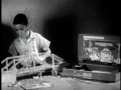 montage b/w ms cu boy building mechanical bridge model and putting doll on bridge / knights ferry, california, usa - bridge built structure stock videos and b-roll footage