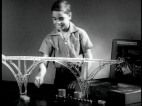 B/W MS Boy building mechanical bridge model / Knights Ferry, California, USA