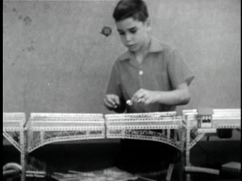 montage b/w ms boy building mechanical drawbridge model / ms tu mechanical drawbridge opening / knights ferry, california, usa - drawbridge stock videos and b-roll footage