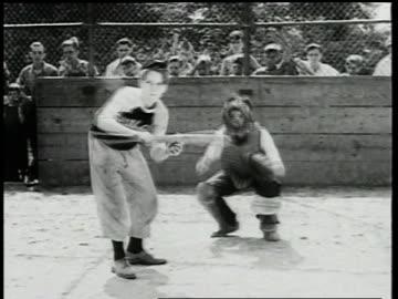 vidéos et rushes de boy bunting and hitting baseball / boys scrambling for ball / ball being thrown to baseman and runner getting tagged - 1947