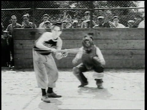 boy bunting and hitting baseball / boys scrambling for ball / ball being thrown to baseman and runner getting tagged - 1947 stock videos & royalty-free footage