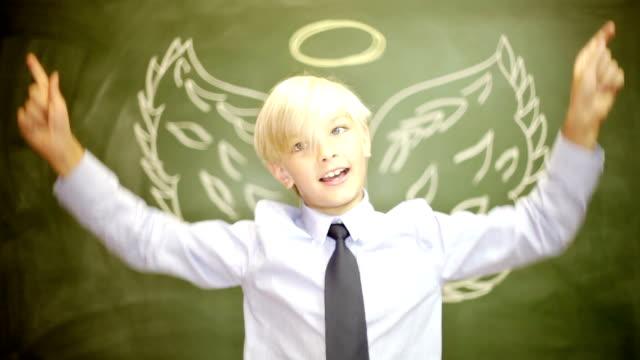 Boy businessman Christianity angel wings and halo or capitalist venture capitalist financier