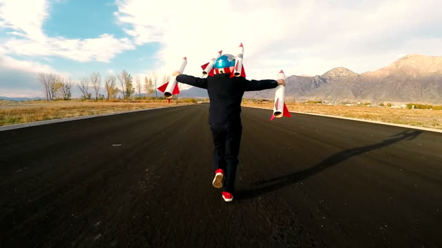boy businessman holding rockets imagines flying - ethereal stock videos and b-roll footage