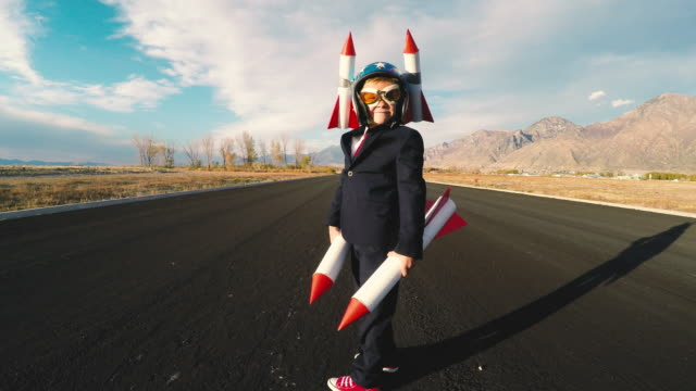 boy businessman holding rockets imagines flying - taking off stock videos & royalty-free footage