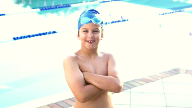 boy by pool wearing swimming goggles and cap - swimming cap stock videos & royalty-free footage