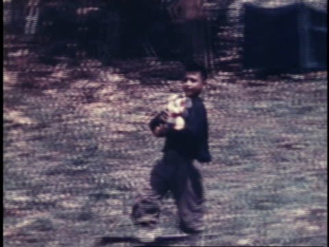 boy carrying cans of food posing and walking on / guam - guam video stock e b–roll