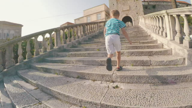 boy climbing stairs - lead stock videos and b-roll footage