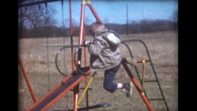 1961 boy climbs slide the hard way