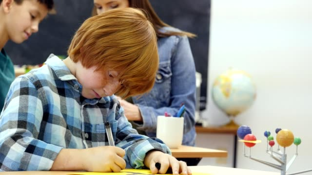 boy concentrates while working on solar system project - elementary school stock videos & royalty-free footage