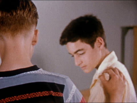 1955 boy consoling friend by placing hand on his shoulder - only teenage boys stock videos & royalty-free footage